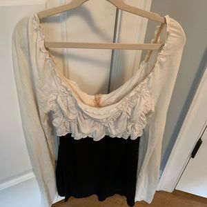 Off the shoulder white and black ruffled shirt
